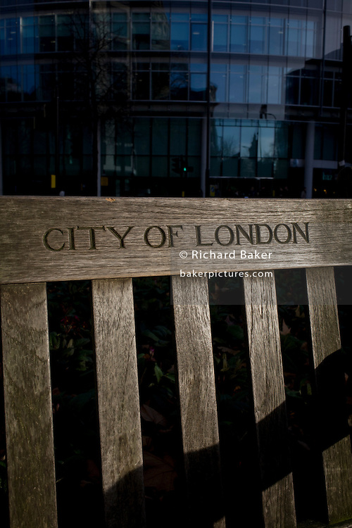City of London bench and modern city background.