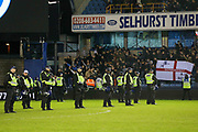 Police form a line not eh pitch after Millwall win during the The FA Cup fourth round match between Millwall and Everton at The Den, London, England on 26 January 2019.