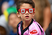 A young Canada fans watches the action during the Cathay Pacific/HSBC Hong Kong Sevens festival at the Hong Kong Stadium, So Kon Po, Hong Kong. on 7/04/2018. Picture by Ian  Muir.