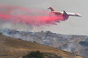July 13, 2015 - Yorba Linda, CA, USA - <br /> <br /> water planes take to the sky to help put out fires<br /> <br /> An air tanker douses burning brush with fire retardant off the 241 toll road Monday near Irvine and Orange. More than 150 acres burned in unincorporated Orange County, California<br /> ©Exclusivepix Media