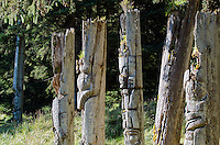 Six historic totems at SGang Gwaay Lingagaay National Historic Site on Haida Gwaii, British Columbia, Canada. A UNESCO World Heritage Site protecting a Northwest Coast First Nations village site.