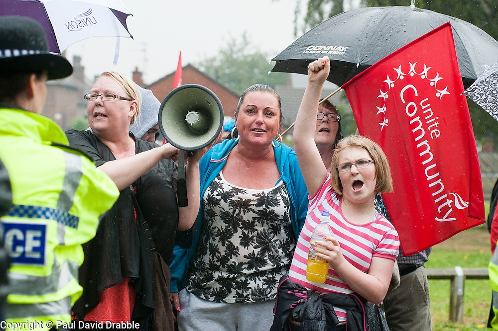 Anti EDL demonstrators should UAF slogans at EDL members holding a rally in Hexthorpe Doncaster South Yorkshire on Saturday. The EDL and UAF are thought to have chosen Hexthorpe after recent media reports of tension between newly arrived Roma residents and the the local community<br /> 18 July 2014<br /> Image &copy; Paul David Drabble <br /> www.pauldaviddrabble.co.uk
