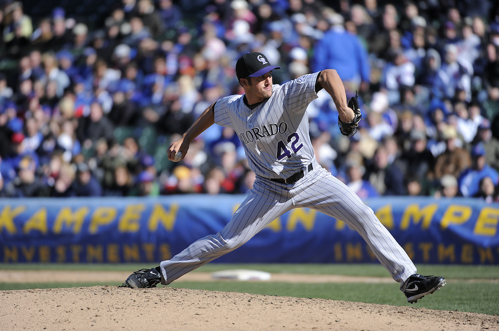 CHICAGO - APRIL 15:  Huston Street #16 of the Colorado Rockies pitches against the Chicago Cubs on April 15, 2009 at Wrigley Field in Chicago, Illinois.  All players wore number 42 on this day only in honor of Jackie Robinson.  The Rockies defeated the Cubs 5-2.  (Photo by Ron Vesely)