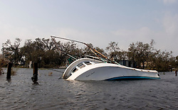 25 Sept, 2005. Lake Calcasieu, Louisiana.  Hurricane Rita aftermath. <br /> Lake Calcasieu shipping canal close to Cameron, Louisiana one day after the storm smashed the coastline. The shrimp boat the 'Cajun Queen' lies sunk in the town of Hackberry.<br /> Photo; &copy;Charlie Varley/varleypix.com