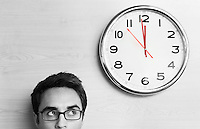 Anxious Businessman Looking at Office Clock