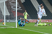 MK Dons striker Alex Revell scores the first goal during the Sky Bet Championship match between Milton Keynes Dons and Huddersfield Town at stadium:mk, Milton Keynes, England on 23 February 2016. Photo by Dennis Goodwin.