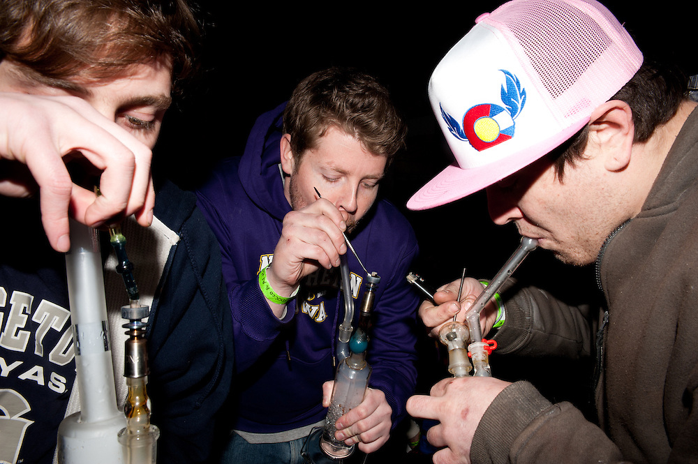 A medical patients' smoking event in Denver. These young men are doing 'dabs' of concentrated hash oil.