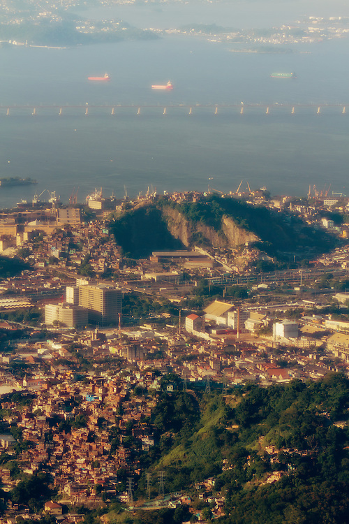 Depth of Rio. Interesting view of Rio with Guanabara Bay, the Niteroi bridge, two slums, downtown buildings all in one big shot.