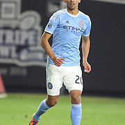 Mehdi Ballouchy, NYCFC, in action during the New York City FC Vs Orlando City, MSL regular season football match at Yankee Stadium, The Bronx, New York,  USA. 18th March 2016. Photo Tim Clayton