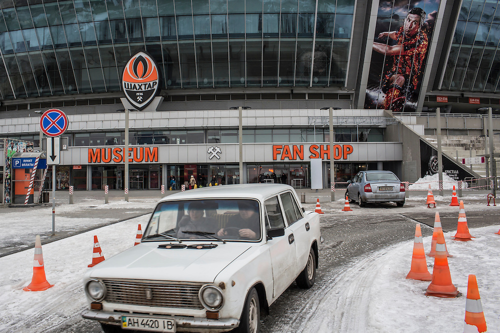 DONETSK, UKRAINE - JANUARY 26, 2015: The Donbass Arena soccer stadium, which no longer hosts games but is instead a large distribution point for food aid and other humanitarian assistance in Donetsk, Ukraine. With many residents finding it difficult to access bank accounts or find work, humanitarian needs are rising. CREDIT: Brendan Hoffman for The New York Times