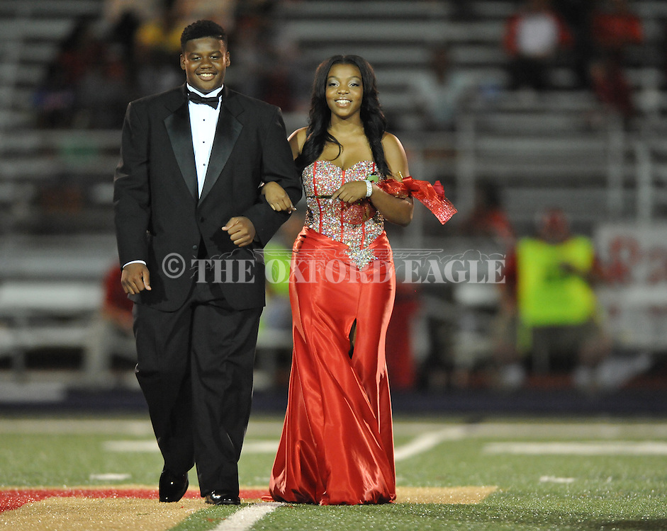 Junior maid Kierra Gipson is escorted by Khalil Martin during Homecoming at Lafayette High vs. Shannon in Oxford, Miss. on Friday, September 19, 2014. Lafayette High won 35-0 to improve to 2-3 on the season.