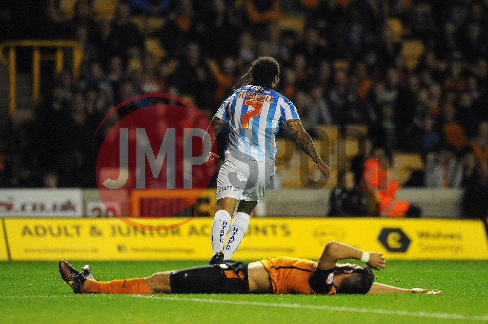 Huddersfield Town's Sean Scannell wheels away in celebration after scoring his sides second goal of the game to make it 0 - 2 as Wolverhampton Wanderers' Danny Batth lies on the floor - Photo mandatory by-line: Dougie Allward/JMP - Mobile: 07966 386802 - 01/10/2014 - SPORT - Football - Wolverhampton - Molineux Stadium - Wolverhampton Wonderers v Huddersfield Town - Sky Bet Championship
