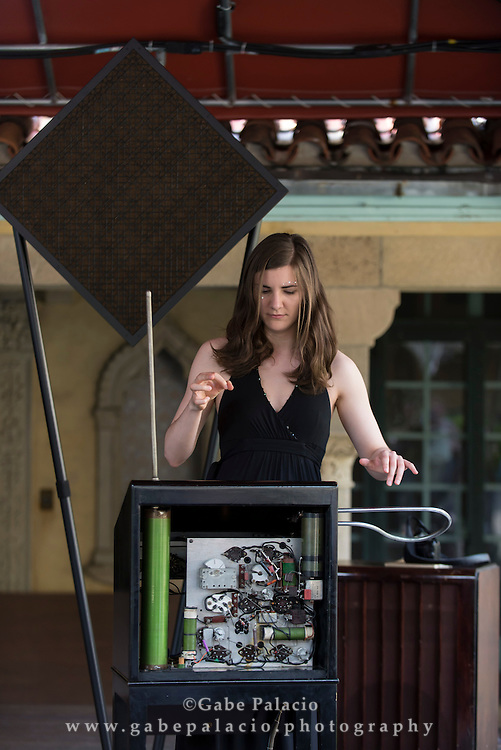 Carolina Eyck, thereminist, tests Lucie Rosen's Theremin during the Theremin&rsquo;s American Home in the  Spanish Courtyard at Caramoor in Katonah New York on July 12, 2015. <br /> (photo by Gabe Palacio)