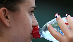 Katy Dunn drinks a bottle of water on day four of the Wimbledon Championships at the All England Lawn Tennis and Croquet Club, Wimbledon. PRESS ASSOCIATION Photo. Picture date: Thursday July 5, 2018. See PA story TENNIS Wimbledon. Photo credit should read: Nigel French/PA Wire. RESTRICTIONS: Editorial use only. No commercial use without prior written consent of the AELTC. Still image use only - no moving images to emulate broadcast. No superimposing or removal of sponsor/ad logos. Call +44 (0)1158 447447 for further information.
