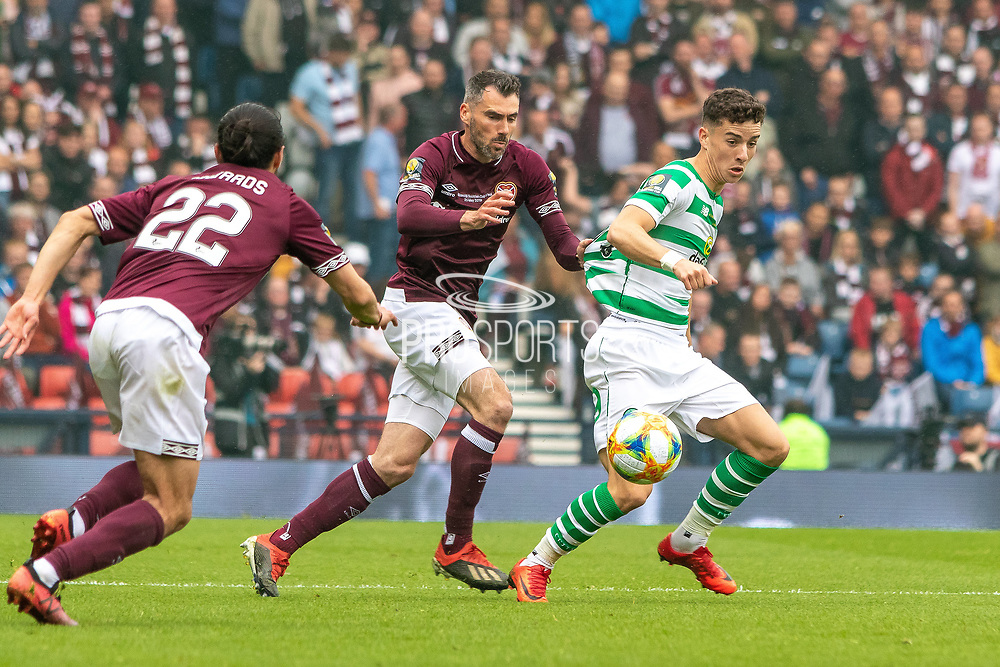 Michael Smith of Hearts has a pull of the shirt of Michael Johnston during the William Hill Scottish Cup Final match between Heart of Midlothian and Celtic at Hampden Park, Glasgow, United Kingdom on 25 May 2019.