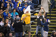 Fans fight for freebies during a timeout in the NBA game between the Golden State Warriors and LA Clippers at Oracle Arena in Oakland, Calif., on January 28, 2017. (Stan Olszewski/Special to S.F. Examiner)