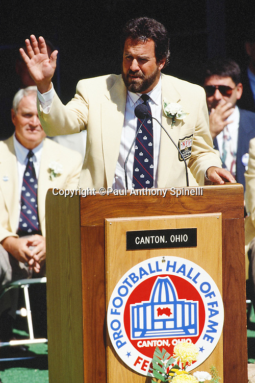 Former San Diego Chargers quarterback Dan Fouts waves to fans during his induction speech at the Pro Football Hall of Fame induction celebration before the Green Bay Packers NFL football game against the Los Angeles Raiders on July 31, 1993 in Canton, Ohio. The Raiders won the game 19-3. (©Paul Anthony Spinelli)