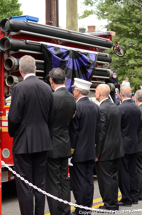 Staten Island, New York - July 10: Ceremonial fire truck carries the casket of  Lt Gordon M. Ambelas past city leaders at the Funeral of Lt Gordon M. Ambelas L119 at Saint Clares Church on July 10, 2014 in New York, New York. Photo Credit: Michael Glenn / Glenn Images