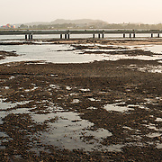 Low tide on the rocky flats on the waterfront of Casco Viejo, Panama City, Panama, on Panama Bay.
