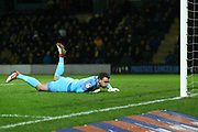 Simon Eastwood of Oxford United (1) watches the ball go wide during the EFL Sky Bet League 1 match between Burton Albion and Oxford United at the Pirelli Stadium, Burton upon Trent, England on 11 February 2020.