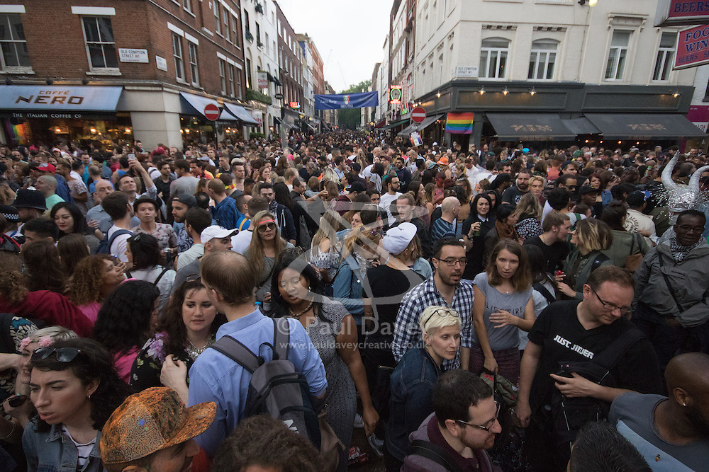 Portland Place, London, June 25th 2016. Thousands of LGBT people and their supporters gather for Pride in London, a colourful celebration of the hard-won rights of lesbian, gay, bisexual and transgender  people. PICTURED: Thousands of people throng Old Compton Street in Soho.