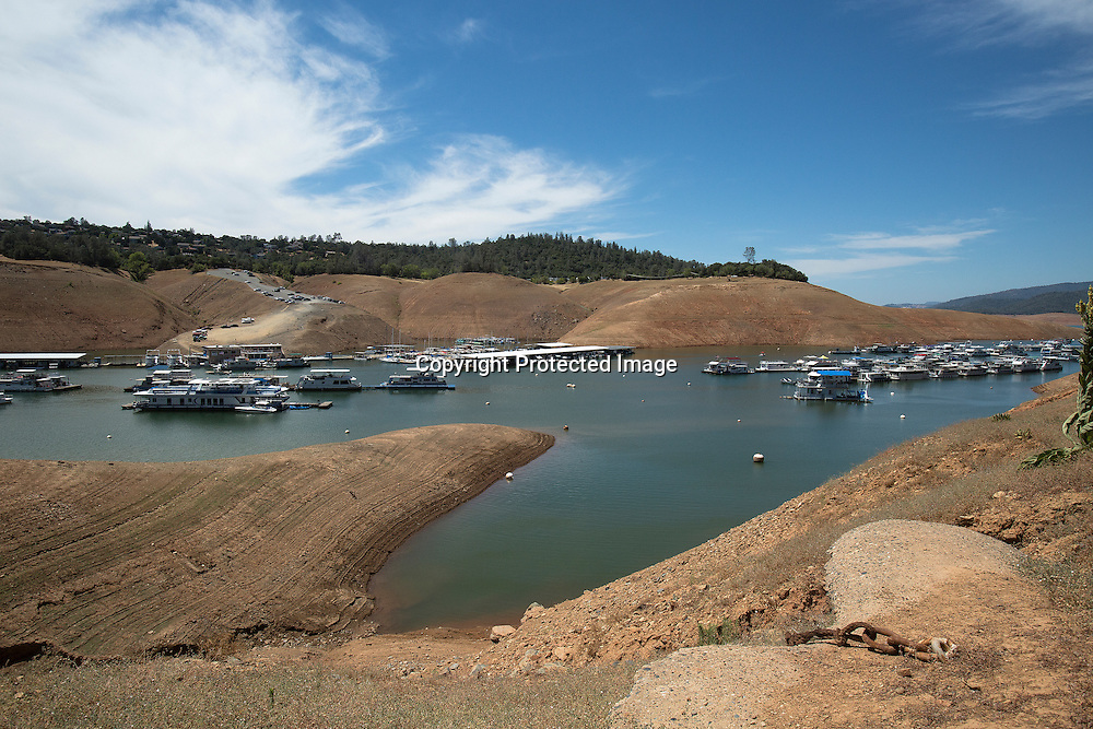 The lower water level in Lake Oroville located in Oroville, Northern California is caused by the severe California drought. It's the single most important reservoir in the California State Water Project providing 70% of the water for Southern California and San Francisco Bay Area urban areas and 30% for irrigation in the Central Valley.