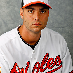 March 1, 2012; Sarasota, FL, USA; Baltimore Orioles starting pitcher Armando Galarraga (59) poses for a portrait during photo day at the spring training headquarters.  Mandatory Credit: Derick E. Hingle-US PRESSWIRE