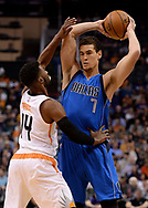 Apr 9, 2017; Phoenix, AZ, USA; Dallas Mavericks forward Dwight Powell (7) handles the ball against Phoenix Suns guard Ronnie Price (14) in the first half of the NBA game at Talking Stick Resort Arena. Mandatory Credit: Jennifer Stewart-USA TODAY Sports