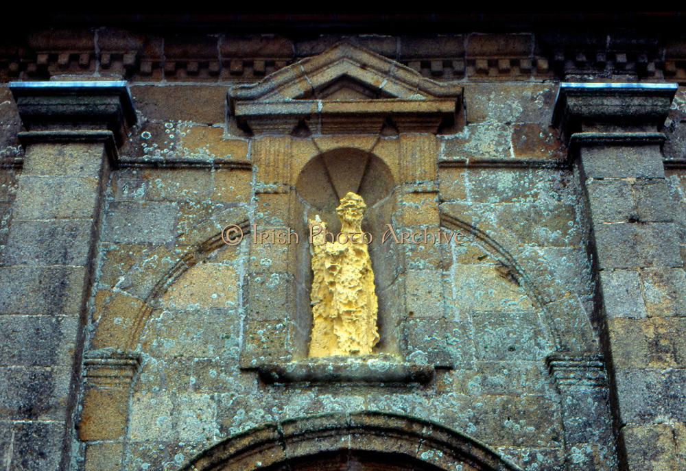 France, Normandy.  Granville. Ext. Eglise Notre-Dame showing erosion of statue.