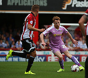 Stephen Quinn (Reading midfielder) trying to find a way through a packed midfield during the Sky Bet Championship match between Brentford and Reading at Griffin Park, London, England on 29 August 2015. Photo by Matthew Redman.