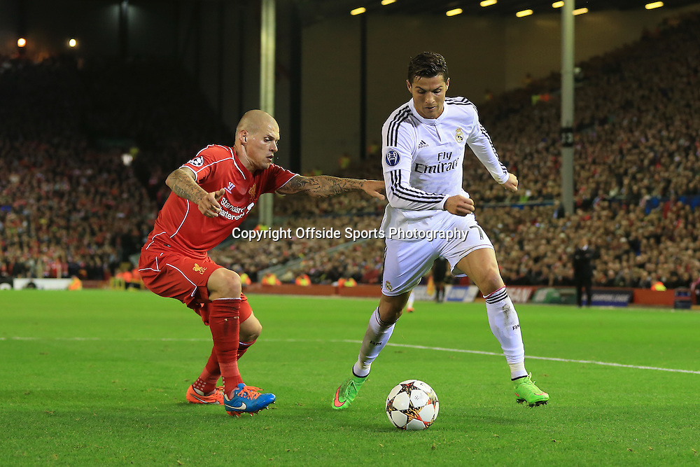 22nd October 2014 - UEFA Champions League - Group B - Liverpool v Real Madrid - Cristiano Ronaldo of Real takes on Martin Skrtel of Liverpool - Photo: Simon Stacpoole / Offside.