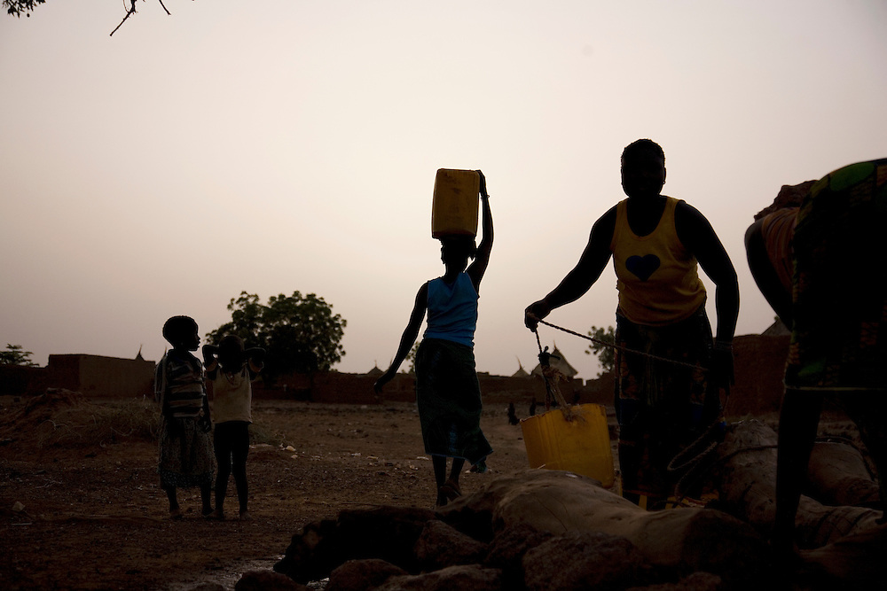Ramata and Aminata fetch water at the end of the day in Nimbou. No model release
