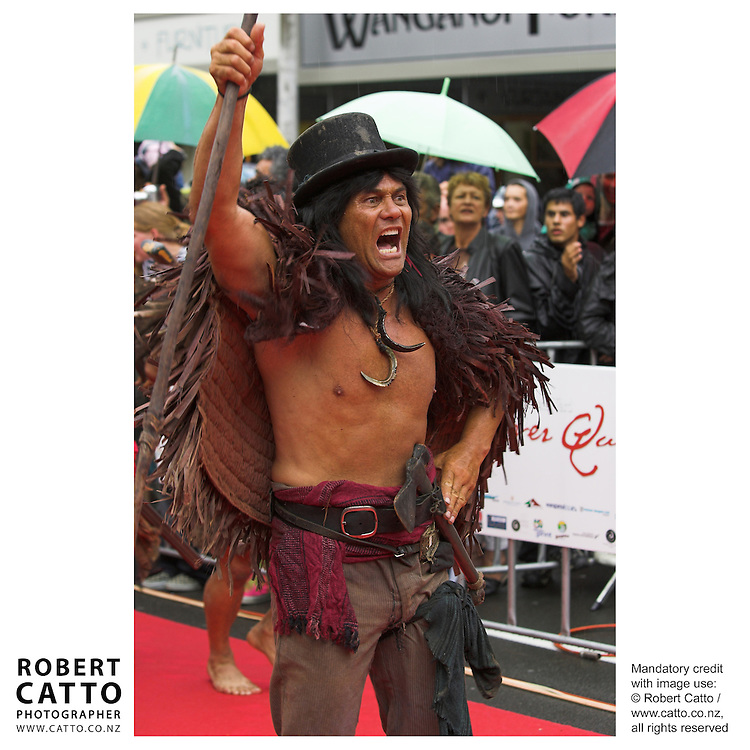 Maori warriors in costumes from the film arrive in at the premiere of River Queen in Wanganui, New Zealand.