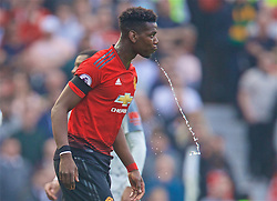MANCHESTER, ENGLAND - Sunday, February 24, 2019: Manchester United's Paul Pogba spits out water during the FA Premier League match between Manchester United FC and Liverpool FC at Old Trafford. (Pic by David Rawcliffe/Propaganda)