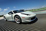 Automotive white Ferrari running