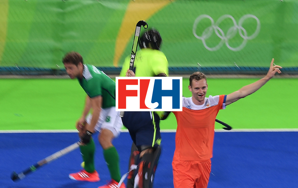 Netherland's Mirco Pruijser (R) celebrates scoring a goal during the men's field hockey Netherlands vs Ireland match of the Rio 2016 Olympics Games at the Olympic Hockey Centre in Rio de Janeiro on August, 7 2016. / AFP / MANAN VATSYAYANA        (Photo credit should read MANAN VATSYAYANA/AFP/Getty Images)