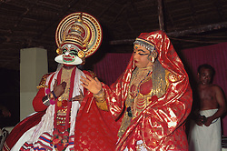 Bright costumes and vivid masks worn by Kathakali dancers at Cochin; Kerala; India,