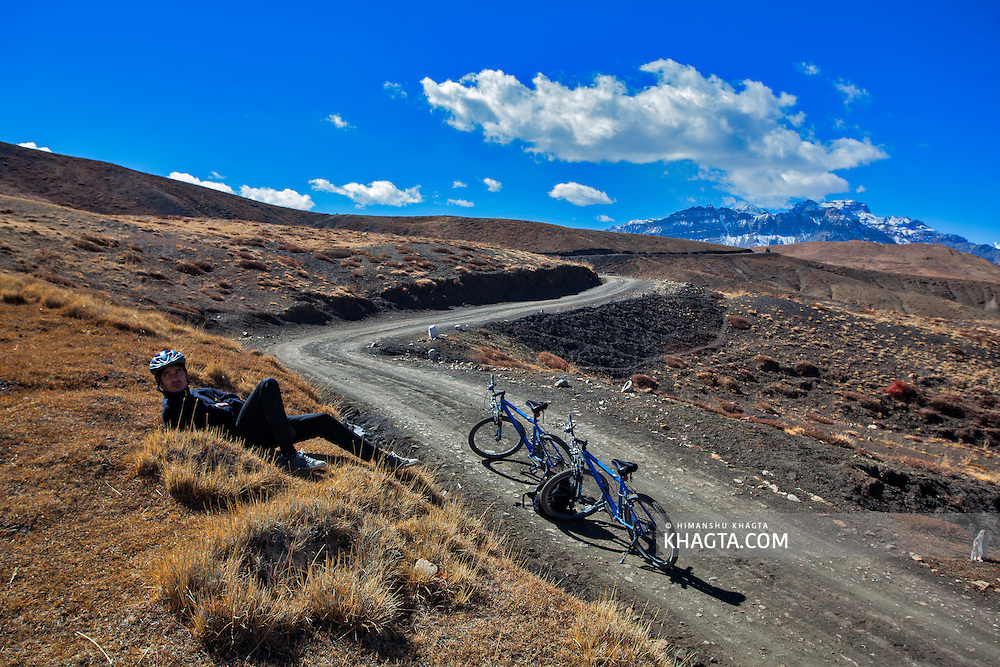 Resting while mountain biking in the high altitude villages of Spiti valley of Himachal Pradesh, India