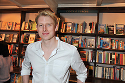MAX JOHNSON at a party to celebrate the publication of Stanley Johnson's new book 'Where The Wild Things Were' held at Daunt Books, 83 Marylebone High Street, <br /> London W1 on 18th July 2012.