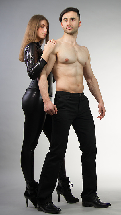 Couple posing together in urban attire.