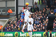 Damien Delaney (27) of Crystal Palace battles in the air and wins header with Liverpool forward Divock Origi (27)   during the Barclays Premier League match between Crystal Palace and Liverpool at Selhurst Park, London, England on 6 March 2016. Photo by Phil Duncan.