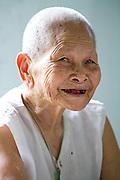 92 year old, Huong Phung enjoys the company at the Chua Dieu Vien Pagoda, Hue, Vietnam.  Photo by Stan Olszewski/SOSKIphoto