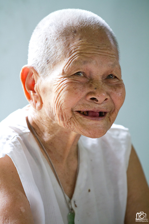 92 year old, Huong Phung enjoys the company at the Chua Dieu Vien Pagoda, Hue, Vietnam.  Photo by Stan Olszewski/SOSKIphoto