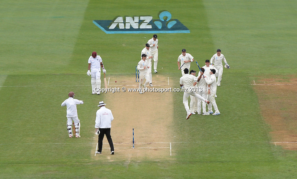Players celebrate a famous win on Day 3 of the 2nd cricket test match of the ANZ Test Series. New Zealand Black Caps v West Indies at The Basin Reserve in Wellington. Friday 13 December 2013. Mandatory Photo Credit: Andrew Cornaga www.Photosport.co.nz
