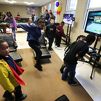 Children at the Northside Boys and Girls Club in Tupelo run into the gameroom on Friday afternoon to find Six gaming consoles along with TV's, stands and new furniture that were donated for the gameroom. The same donations were also made to the Haven Acres location.