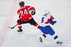 Manuel Geier of Austria and Mitja Robar  of Slovenia during ice-hockey match between Austria and Slovenia at IIHF World Championship DIV. I Group A Slovenia 2012, on April 21, 2012 at SRC Stozice, Ljubljana, Slovenia. (Photo By Matic Klansek Velej / Sportida.com)