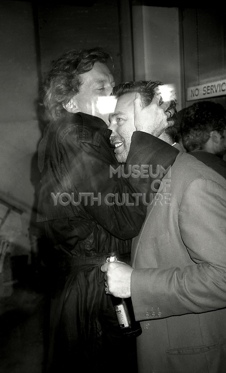 Tony Wilson kisses Peter Hook of New Order, UK, 1990s