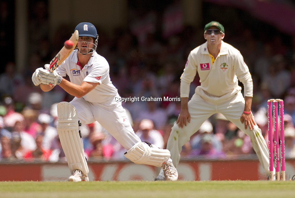Alastair Cook off Michael Beer as Michael Hussey watches during his century in the fifth and final Ashes test match between Australia and England at the SCG in Sydney, Australia. Photo: Graham Morris (Tel: +44(0)20 8969 4192 Email: sales@cricketpix.com) 05/01/11