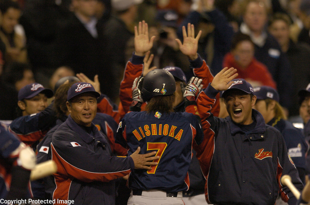 Team Japan's Tsuyoshi Nishioka #7 is congratulated after scoring in the 9th inning against Team Cuba in Final action of the World Baseball Classic at PETCO Park, San Diego, CA.