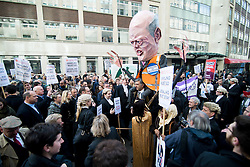 © Licensed to London News Pictures. 07/03/2014. Westminster, London, UK. A crowd of protestors gather outside the Ministry of Justice with an effigy of Justice Secretary Chris Grayling as part of the Save UK Justice campaign against government-proposed legal aid cuts. Photo credit : David Tett/LNP